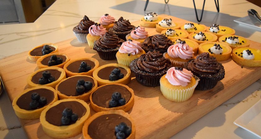 a wooden tray of cupcakes