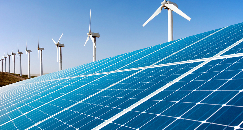 Solar panels and a row of white windmills