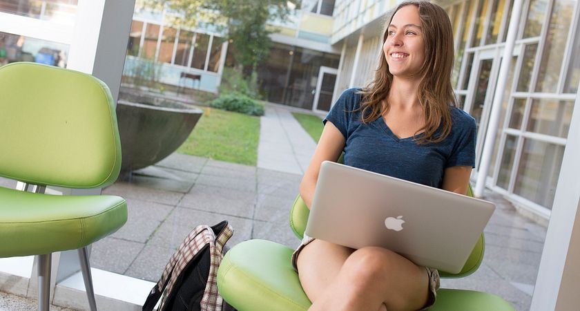A female student accessing the student town hall via her laptop