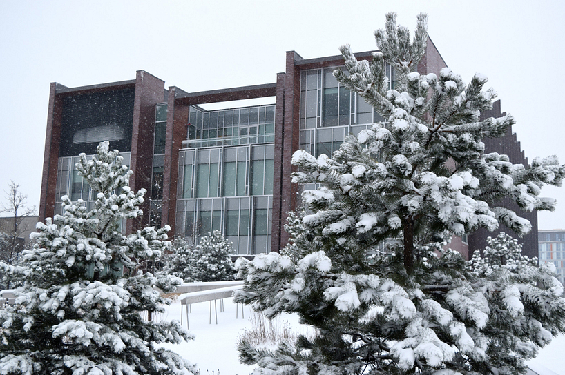 progress campus library building covered with snow