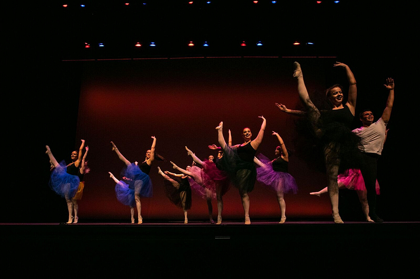 A group of ballerinas perforing on stage