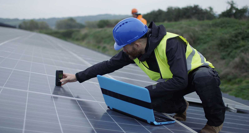 A man installing solar panels outdoors