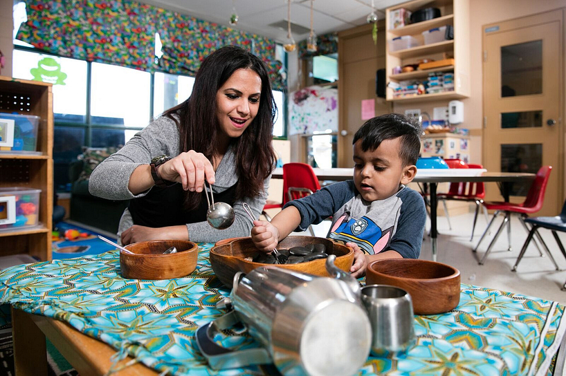 centennial college early childhood education student playing with a child in daycare