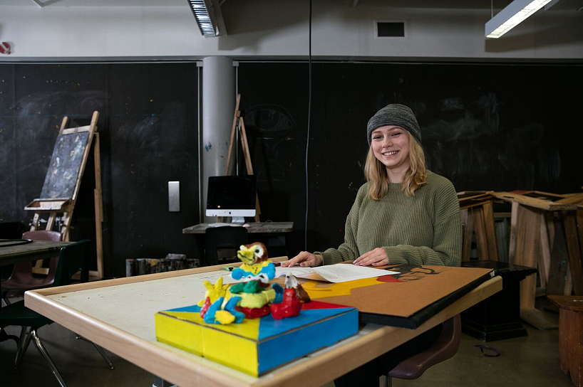 centennial college student smiling in a sculpting class