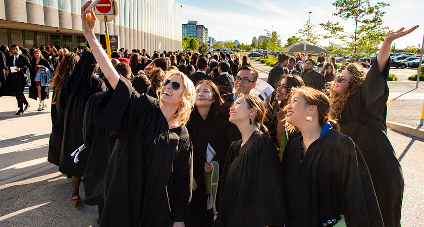 Centennial College graduates taking a selfie photo at Convocation