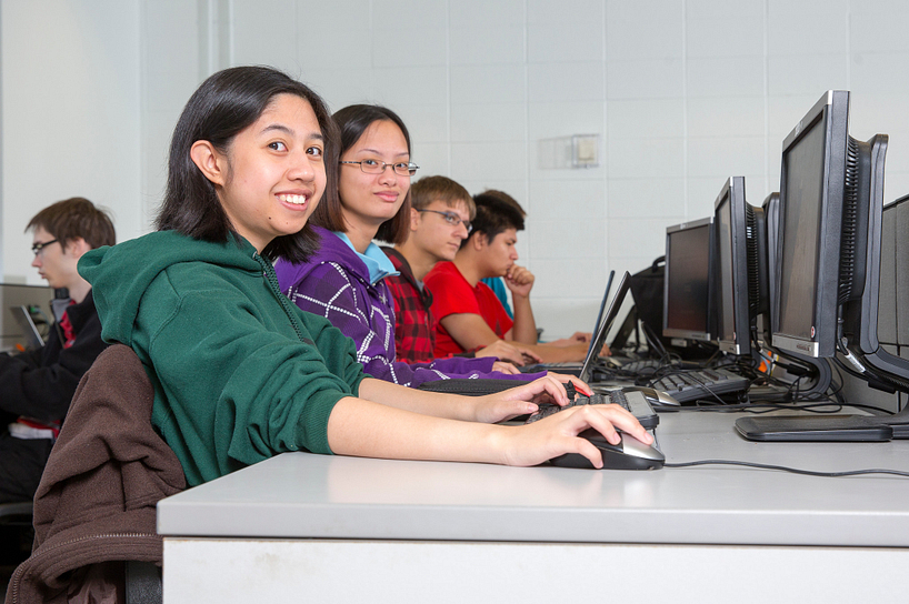 centennial college students working in a computer lab and smiling