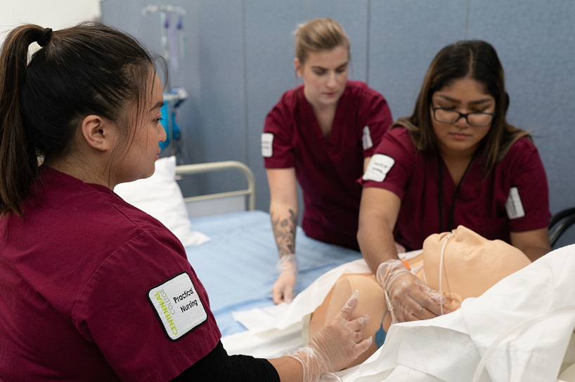 Registered practical nursing students taking care of a patient
