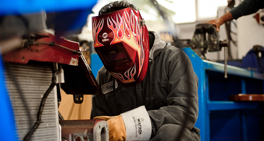 welding student in an auto body lab