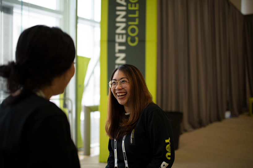 centennial college advisor laughing while talking with a future student