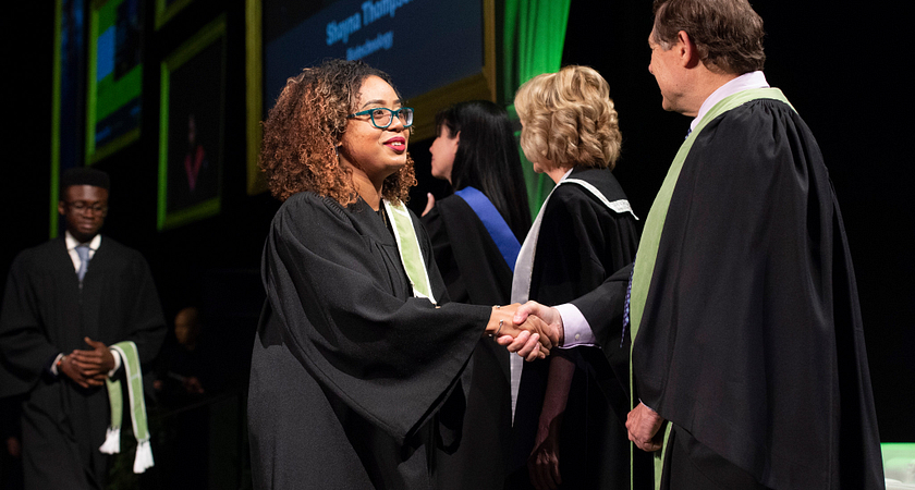 Students accepting their convocation award during their graduation ceremony at Centennial College