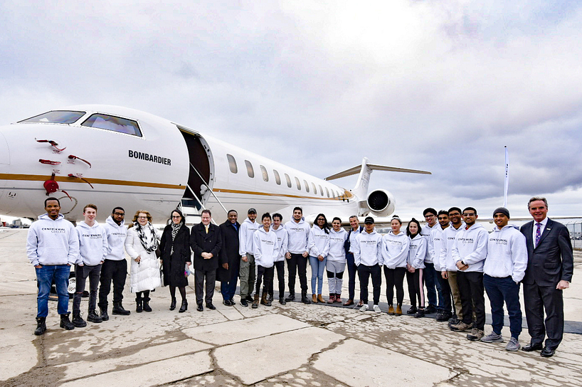 bombardier donated plane with centennial college students and community members standing in front of it