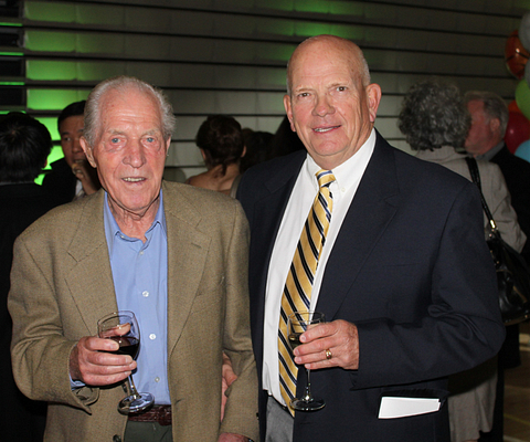 Picture of Retired Centennial College Athletics Director Chuck Gullickson (right, with Centennial retiree Willy Mueller) photographed at the Athletic and Wellness Centre official opening in October, 2011