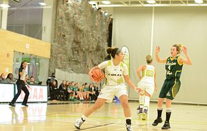 picture of a Centennial College Colts womens basketball player dribbling the ball
