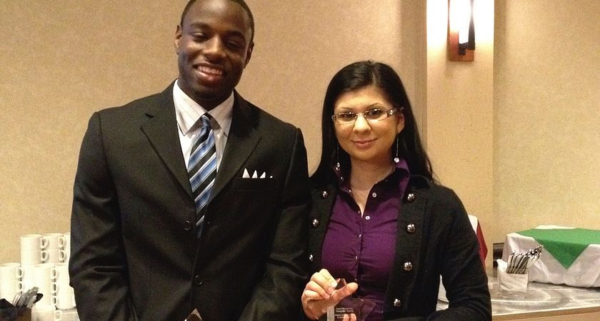 Picture of Centennial College Child and Youth Worker students Kadeem Daley and Diana Pahl receiving the Rising Star award.