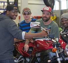 Students working on a motorcycle at the small engine labs