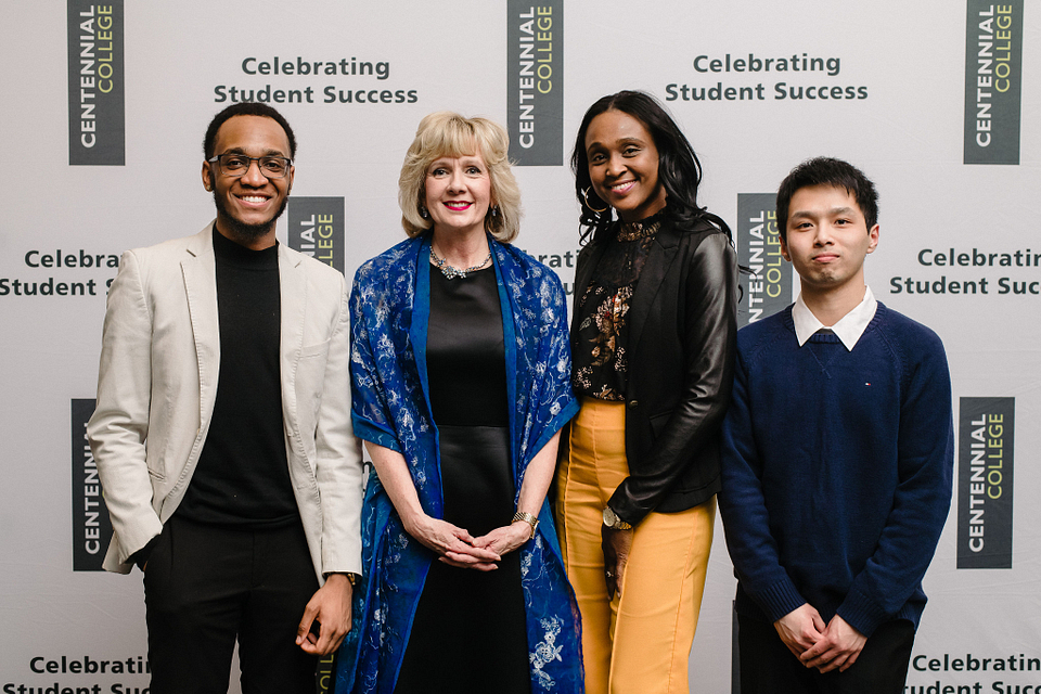 Photo of Ann Buller attending her last Student Awards Night with recipients Nathaniel Dayes (left), Senovia Mckenzie and Samny Yang on March 28, 2019.