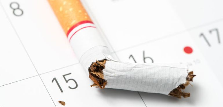 cigarette over a calendar - quit-smoking messages