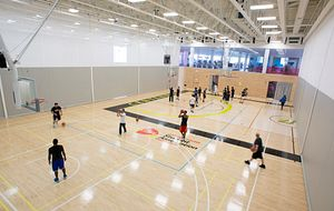 picture-of-Centennial-College-students-playing-basketball-in-the-Athletics-Wellness-Centre-gym