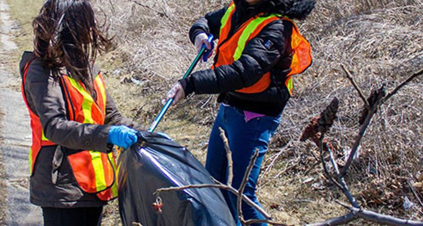 Centennial College students cleaning up garbage in the local community