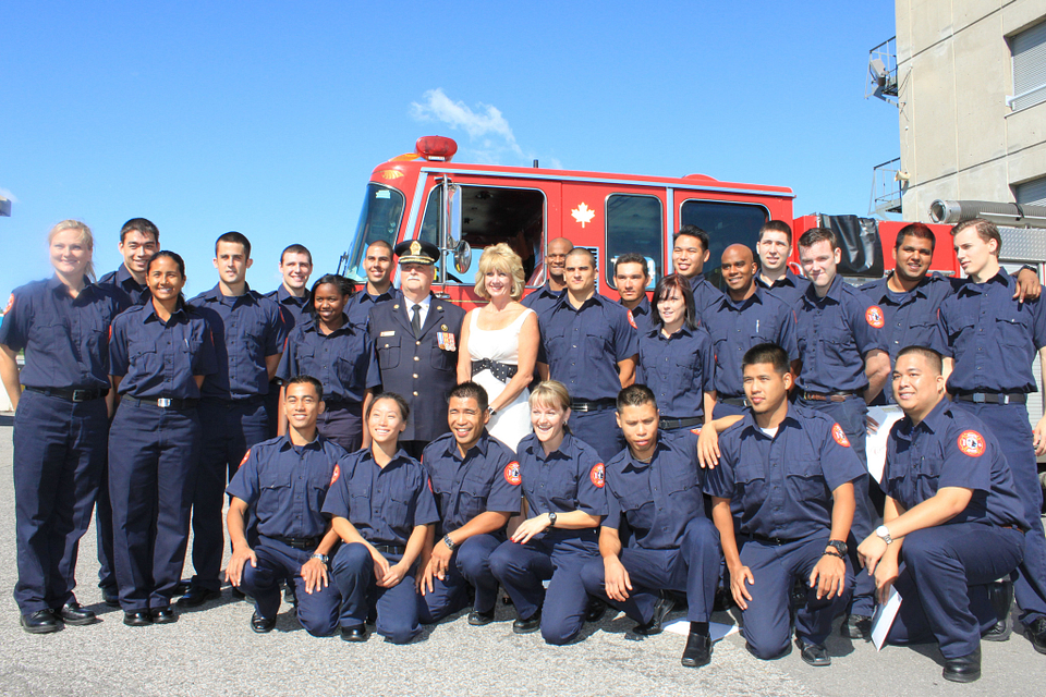 Photo of Ann Buller with the first Pre-service Firefighter graduating class at Eastern Avenue Training Centre, 2011.