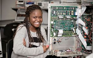 picture of student fixing technology