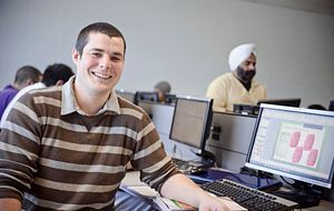 Picture of a centennial College student on a computer smiling