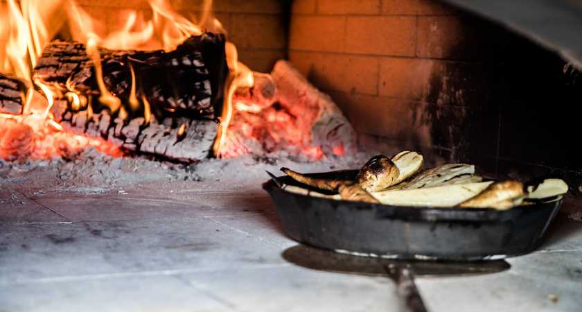 The culinary secrets of wood-fired ovens image