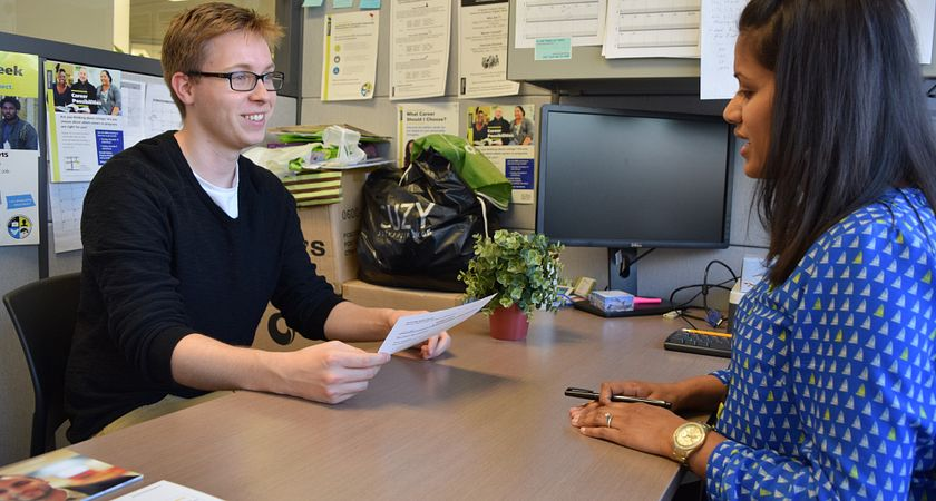 Picture of a student doing a practice interview with a career advisor