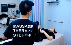picture of a centennial college massage therapy student at the benefit clinic fundraiser to fight aids in africa