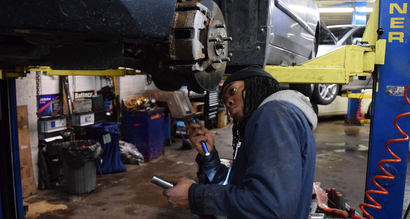 Picture of Automotive Technician Apprenticeship Student Nicholas Lewis working on a car