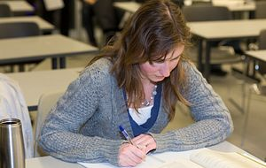 Picture of a Centennial College student writing an exam