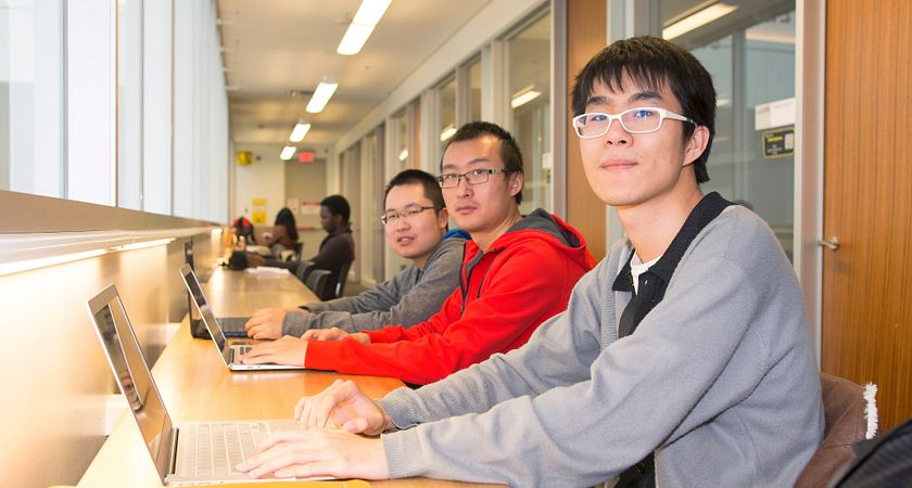 Centennial College students studying together in the library.