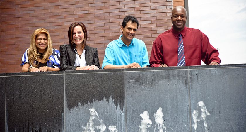 Four Second Career students stand behind the water fountain at the back of the L building at Progress campus