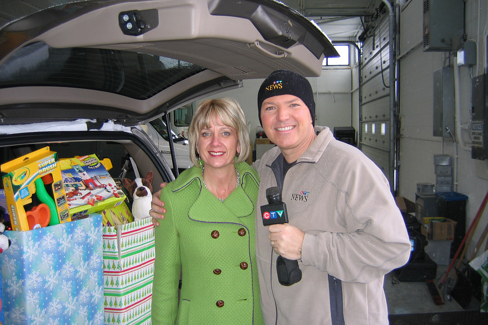 Photo of Ann Buller with CTV personality Tom Brown at the Salvation Army Holiday Toy Drive, 2008.