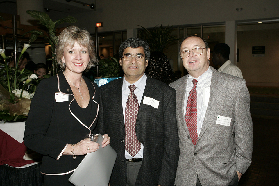 Photo of Ann Buller with Business professor Ragu Nayak and scholarship donor Paul Cook at Student Awards Night, 2004.