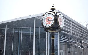 Picture of the Centennial College Alumni Association clock in the Progress Campus courtyard covered with snow in the winter