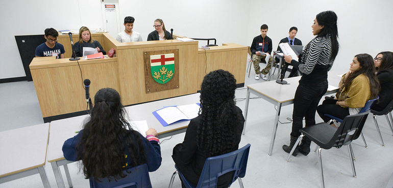 law students in a mock courtroom