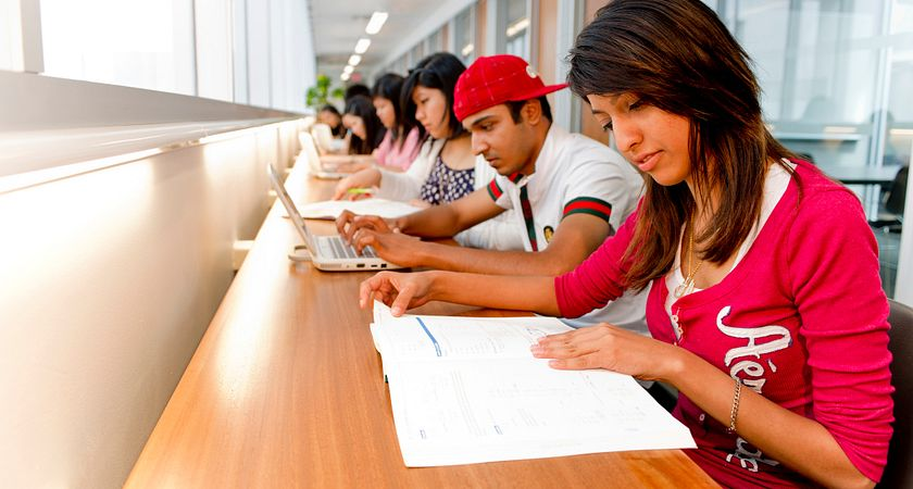 photo of students studying at the library of progress campus