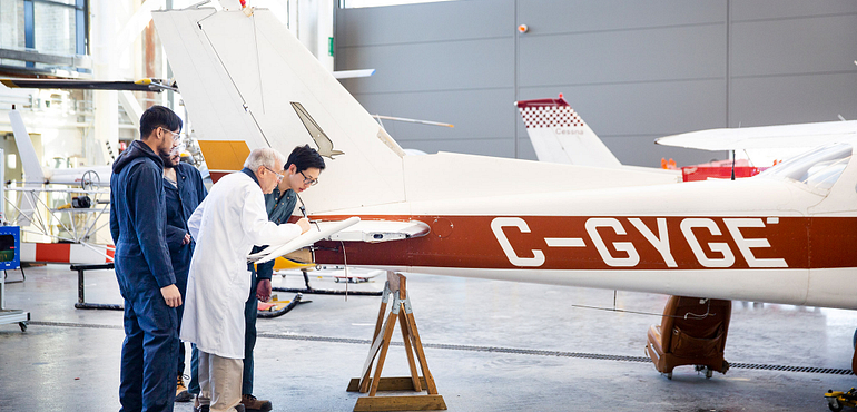 aviation students working on an airplane