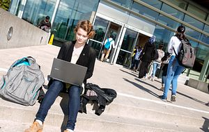 picture of a centennial college student sitting outside morningside campus updating their passwords