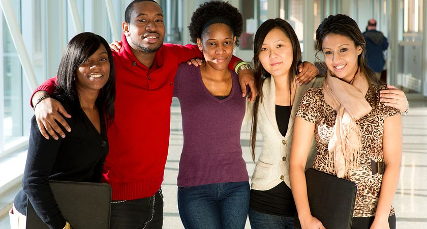 Picture of a group of Centennial College students on campus in the summer