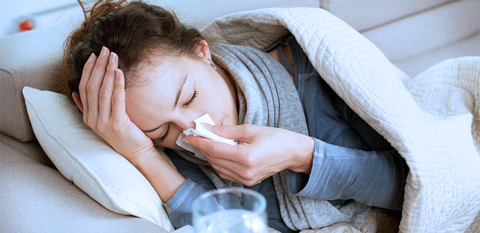 Woman sick in bed with the flu