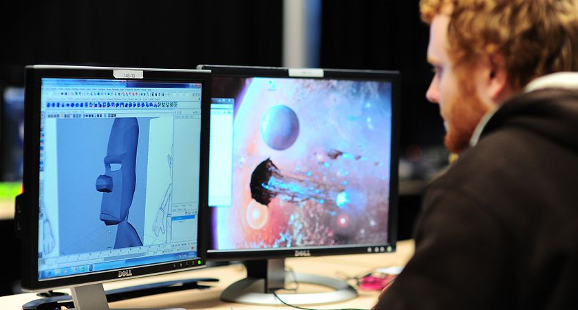 Male Digital Animation student works on his character design with his dual screens at the animation studio at the Story Arts Centre