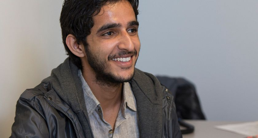 Picture of a Centennial College Customer Service Management student in class smiling