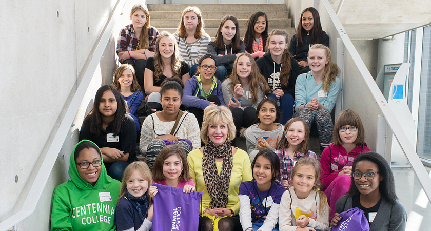 picture of President Ann Buller with a group of young girls visiting from Toronto middle schools