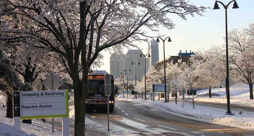 picture of a TTC bus approaching Centennial College Progress Campus on a snowy day