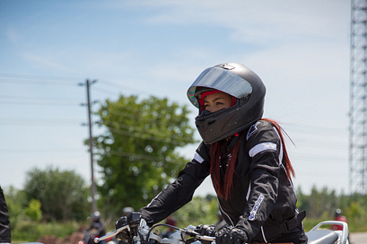 picture of a centennial college motorcycle rider training student on their bike ready to ride