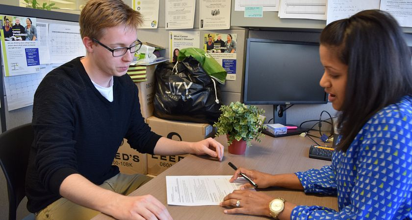 Picture of a student receiving advice from a counsellor