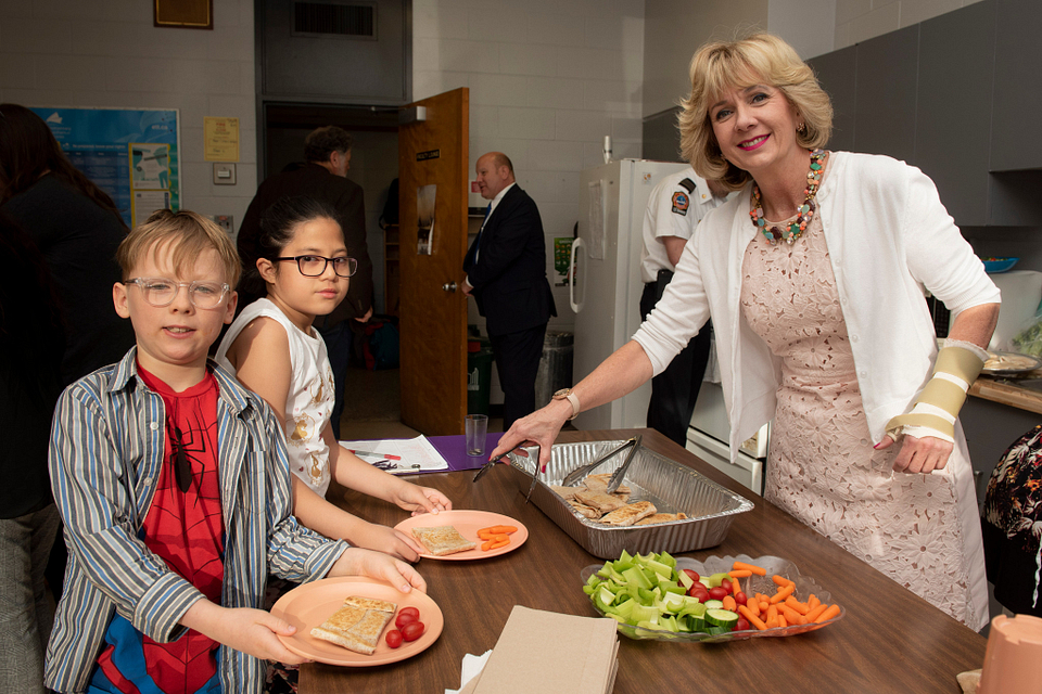 Photo of Ann Buller helping out at the Warden Woods Public School Breakfast Club, 2018.