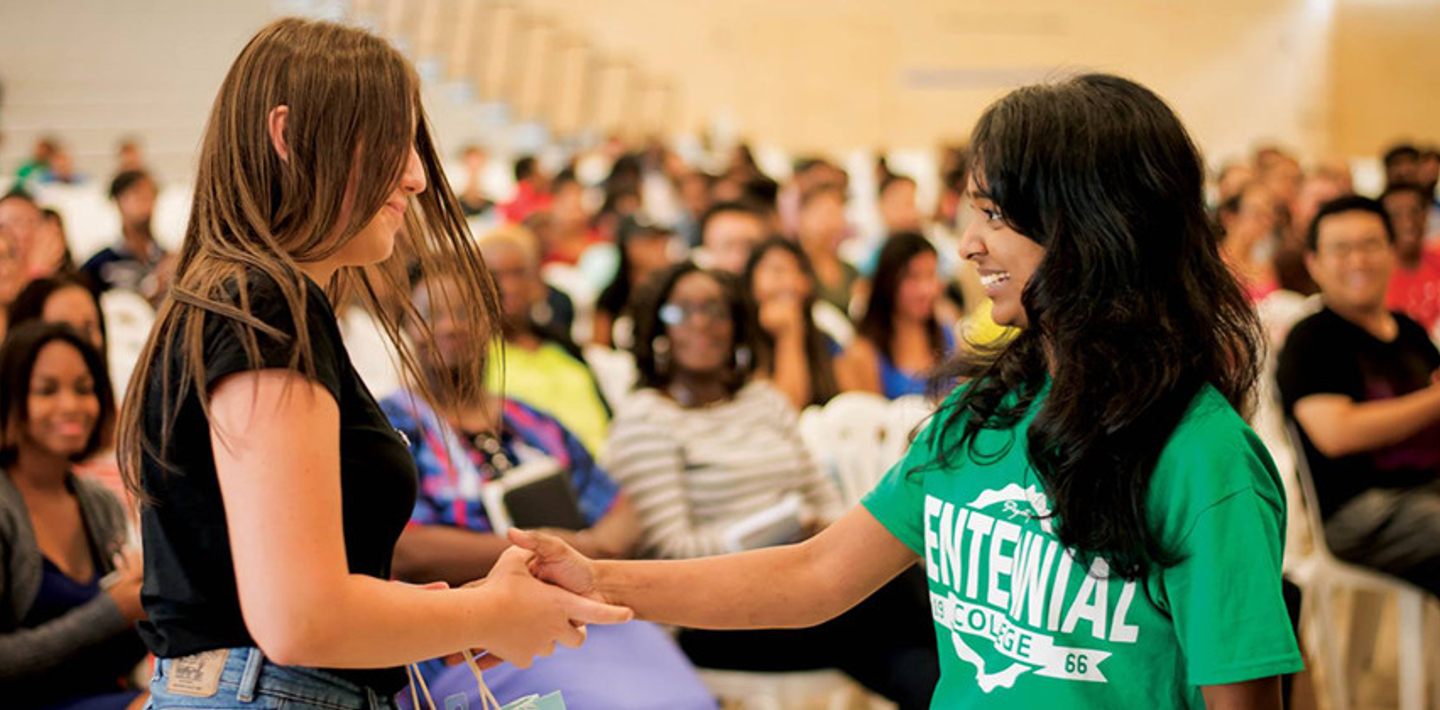 picture of a Centennial College International Education Ambassador greeting a new student